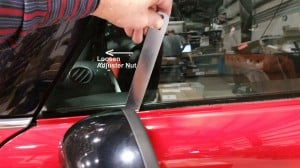MINI Cooper 2nd gen window adjustment using adjuster wrench to loosen height adjuster nut BAVauto