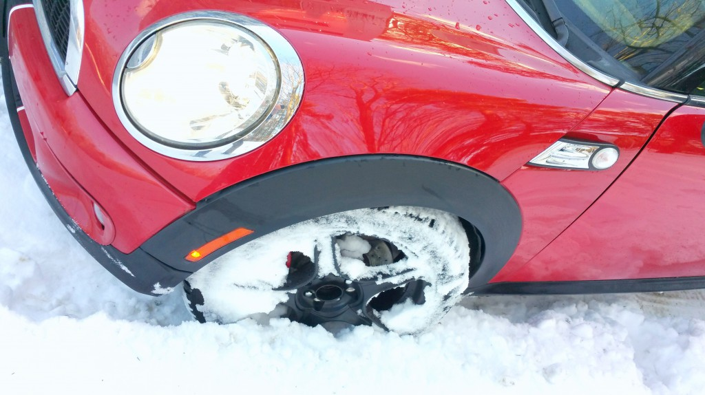 Mini Cooper wheel packed with snow BAVauto